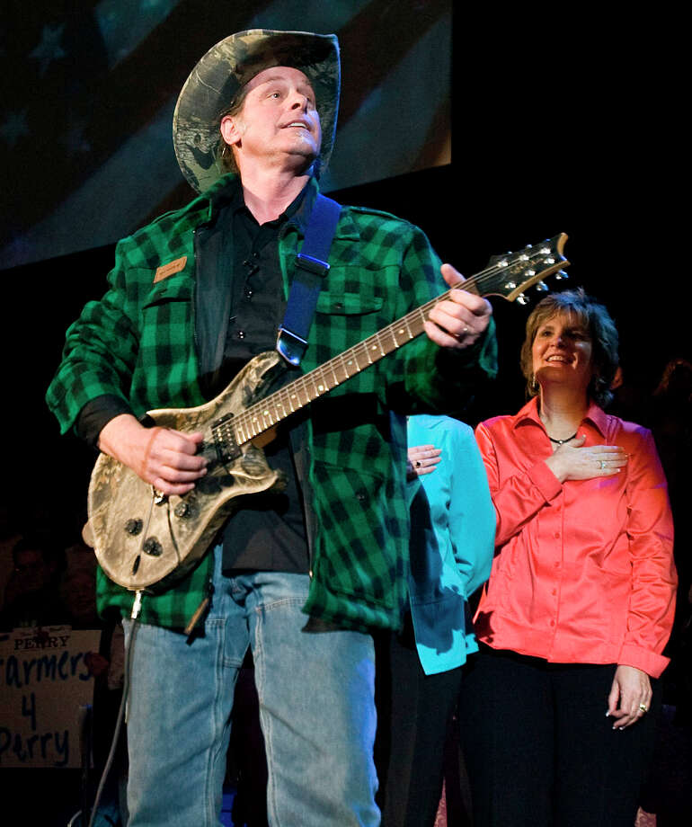 Ted Nugent play the national anthem at a political where Former Alaska Governor Sarah Palin endorses Texas Governor Rick Perry reelection campaign at Cy-Fair ISD's Berry Center Sunday, Feb. 7, 2010, in Cypress. Photo: James Nielsen, Chronicle / Houston Chronicle