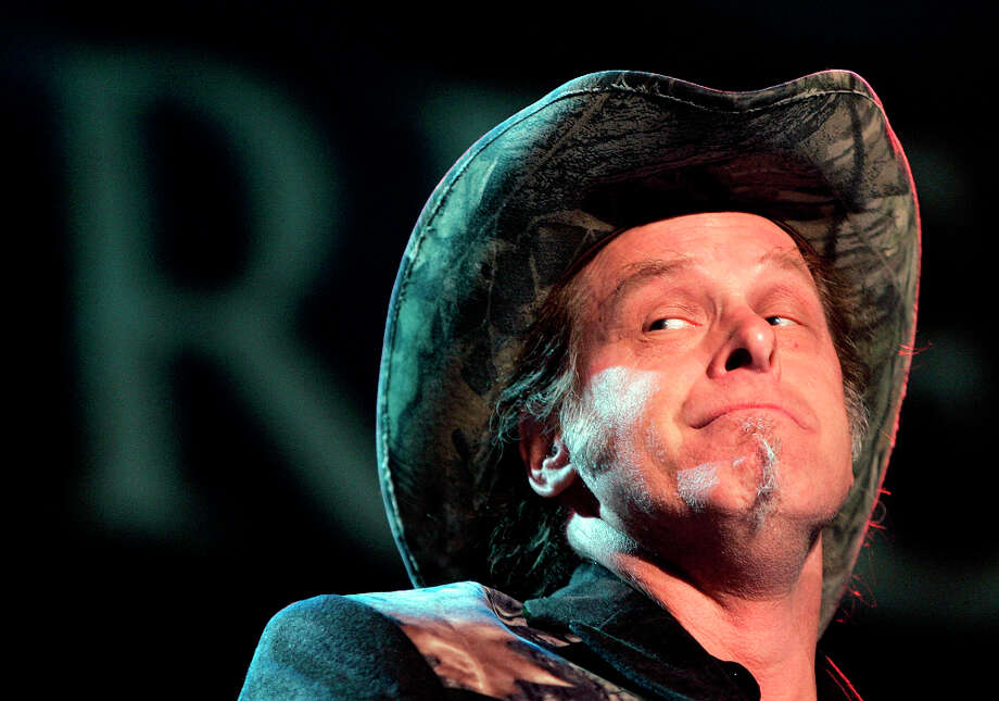 In this May 19, 2006 file photo, Ted Nugent performs during the opening ceremony of the National Rifle Association annual convention  in Milwaukee.  Nugent conducted an estate sale over the weekend, peddling big game trophies to make relocation to a nearby Texas ranch a bit easier. Photo: MORRY GASH, AP / AP