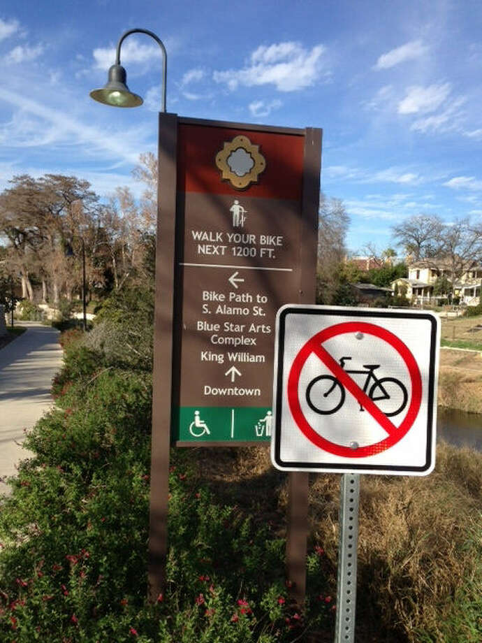 A city sign prohibits bikes for 1,200 feet from Blue Star to Guenther Street along the San Antonio River. Photo: Courtesy Photo