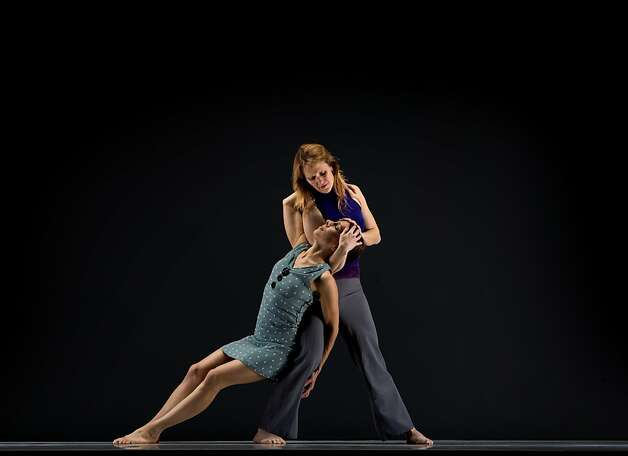 Liz Burritt (standing) and Marit Brook-Kothlow dance in Joe Goode Performance Group's romantic retrospective. Photo: RJ Muna