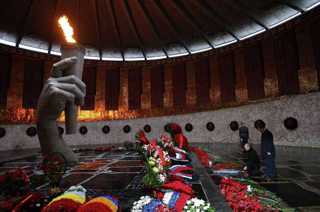 Russian President Vladimir Putin kneels to lay a wreath at the Eternal Flame to mark 70th anniversary of the Battle of Stalingrad in the southern Russian city of Volgograd, once known as Stalingrad. The battle   led to the defeat of Germany. Photo: Alexander Zemlianichenko, Associated Press