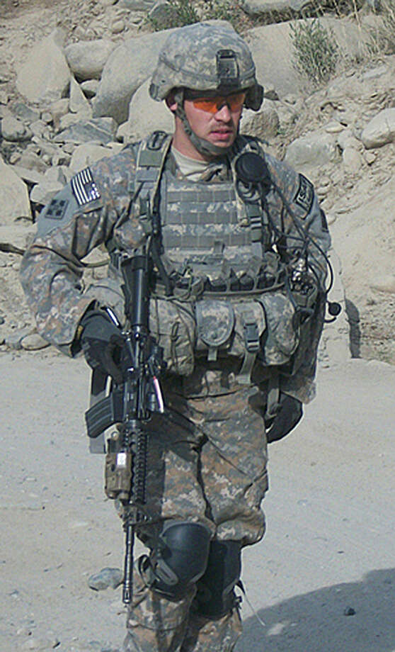 Former Army Staff Sgt. Clinton L. Romesha, shown in Afghanistan in 2009, was awarded the Medal of Honor on Monday by President Barack Obama. Photo: Getty Images