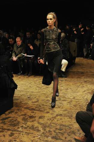 A model walks the runway at the Donna Karan New York Fall 2013 fashion show during Mercedes-Benz Fashion Week at 547 W 26th Street on February 11, 2013 in New York City.  Photo: Mike Coppola, (Credit Too Long, See Caption) / 2013 Getty Images