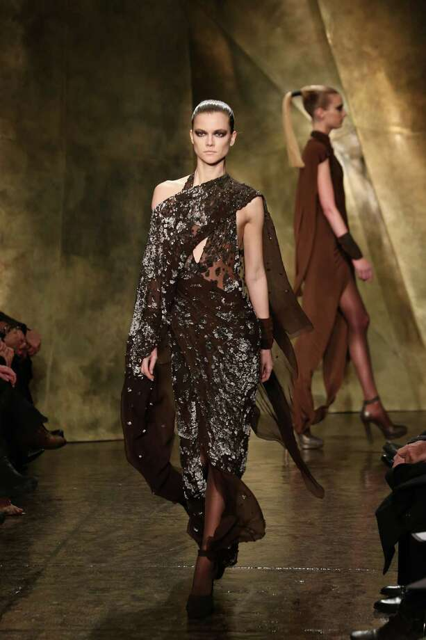 A model walks the runway at the Donna Karan New York Fall 2013 fashion show during Mercedes-Benz Fashion Week at 547 W 26th Street on February 11, 2013 in New York City. Photo: Neilson Barnard, (Credit Too Long, See Caption) / 2013 Getty Images