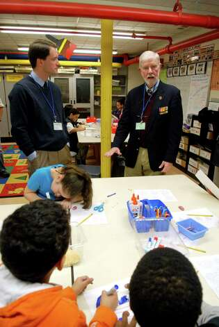 Congressman Jim Himes and Vietnam veteran Phil Kraft help students in Catie Ramsey's 3rd grade art class at KT Murphy Elementary School in Stamford, Conn. make valentines for veterans on Monday February 13, 2013. Photo: Dru Nadler / Stamford Advocate Freelance
