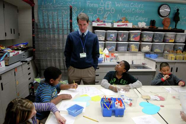 Congressman Jim Himes  helps students in Catie Ramsey's 3rd grade art class at KT Murphy Elementary School in Stamford, Conn. make valentines for veterans on Monday February 13, 2013. Photo: Dru Nadler / Stamford Advocate Freelance