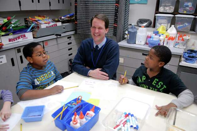 Congressman Jim Himes talks to students Raphy Benjamin and Jaydon Carter  at KT Murphy Elementary School in Stamford, Conn. and helps them make valentines for veterans on Monday February 13, 2013. Photo: Dru Nadler / Stamford Advocate Freelance