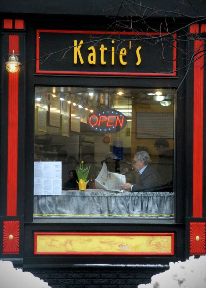 David Wallman enjoys lunch and his newspaper at Katie's Gourmet restaurant on Bank St in Stamford, Conn. on Monday February 11, 2013. Photo: Dru Nadler / Stamford Advocate Freelance