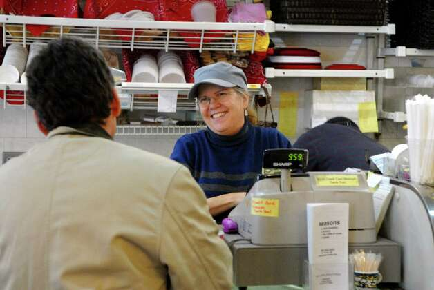 Liz Costas, who owns Katie's Gourmet in Stamford, Conn. restaurant with husband Phillip, waits on a customer on Monday February 11, 2013. Photo: Dru Nadler / Stamford Advocate Freelance
