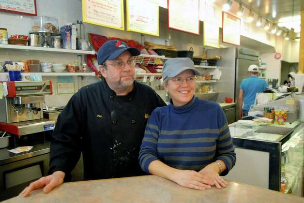 Katie's Gourmet restaurant on Bank St in Stamford, Conn. is changing it's name to Seasons and expanding it's hours, owners Phillip and Liz Costas pose in the restaurant on Monday February 11, 2013. Photo: Dru Nadler / Stamford Advocate Freelance