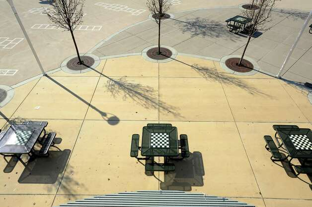 "Energy efficient ""cool pavement"" is seen on the playgound area of King Elementary School in Richmond, CA Wednesday February 6th, 2013.  ""Cool Roofs and Pavement"" are specifically made pavement and white roofs that reflect back more light and heat, using technology developed at Lawrence Berkeley Lab. Photo: Michael Short, Special To The Chronicle / ONLINE_YES"