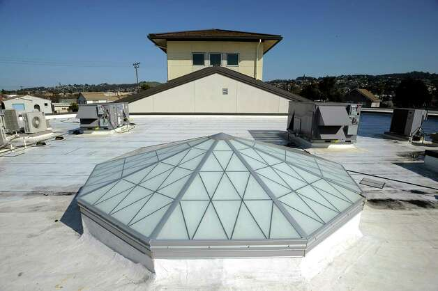 "A large energy efficient skylight and ""cool roofing"" is seen on the roof of the library at King Elementary School in Richmond, CA Wednesday February 6th, 2013.  ""Cool Roofs and Pavement"" are specifically made pavement and white roofs that reflect back more light and heat, using technology developed at Lawrence Berkeley Lab. Photo: Michael Short, Special To The Chronicle / ONLINE_YES"
