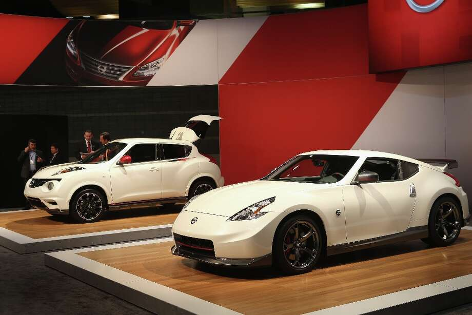 CHICAGO, IL - FEBRUARY 07: Nissan displays their 2013 Juke NISMO (L) and the 2014 370Z NISMO edition at the Chicago Auto Show on February 7, 2013 in Chicago, Illinois. The Chicago Auto Show, one of the oldest and largest in the country, will be open to the public February 9-18. Photo: Scott Olson, Getty Images / 2013 Getty Images