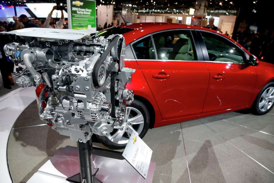 Pictured is the 2014 Chevrolet Cruze Diesel engine unveiled at the Chicago Auto Show Thursday, Feb. 7, 2013, in Chicago. (AP Photo/Charles Rex Arbogast) Photo: Charles Rex Arbogast, Associated Press / AP