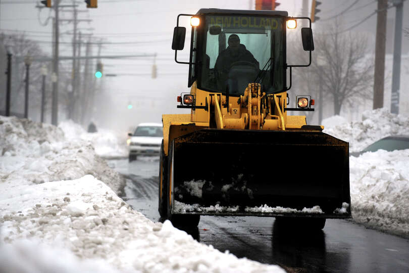 Traffic is limited to one lane cleared of snow along Stratford Ave., in Bridgeport, Conn., Feb. 11th