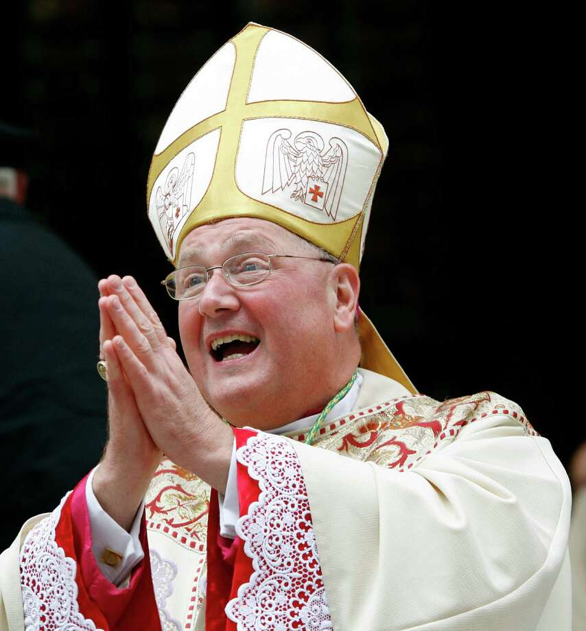 (FILES) - This file picture taken on April 15, 2009 outside St Patrick's Cathedral in New York shows New New cardinal Timothy Dolan who appears like one of the cardinals likely to succeed to Pope Benedict XVI who announced on February 11, 2013  will step down at the end of this month after an eight-year pontificate.   AFP PHOTO/POOL/Mike SegarMIKE SEGAR/AFP/Getty Images Photo: MIKE SEGAR, Pool / AFP