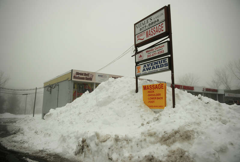 Enormous piles of snow outside businesses on the Post Road in Milford, Conn. on Monday, February 11,
