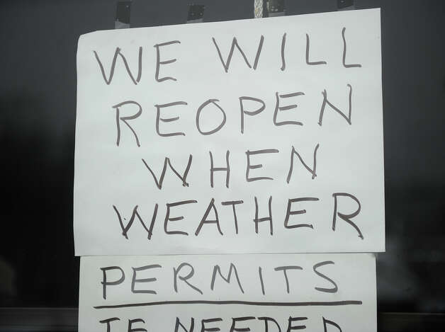 A sign in the door of a business on the Post Road in Milford, Conn. on Monday, February 11, 2013. Photo: Brian A. Pounds / Connecticut Post