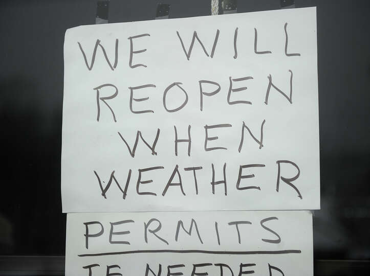 A sign in the door of a business on the Post Road in Milford, Conn. on Monday, February 11, 2013.