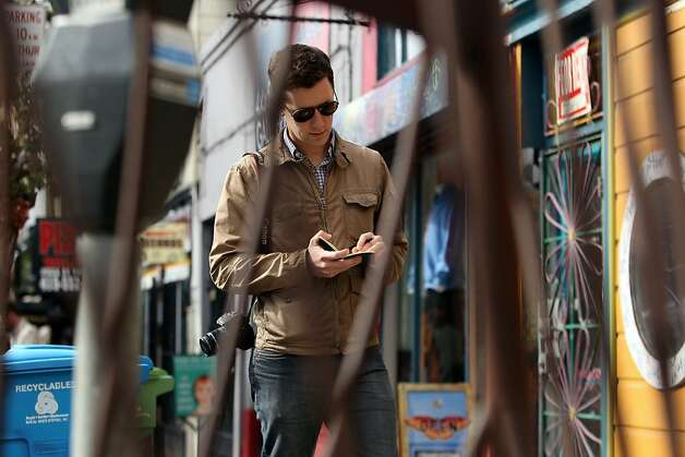 Andrew Dudley writing down notes for his blog on Haight St. on February 7th, 2013 in San Francisco, Calif.  Andrew Dudley is the editor of Haighteration, a lower Haight blog. Photo: Jessica Olthof, The Chronicle