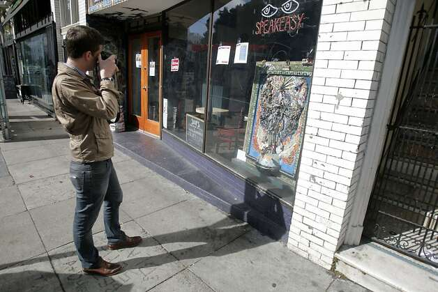 Andrew Dudley taking a picture of art for his blog on Haight St. on February 7th, 2013 in San Francisco, Calif.  Andrew Dudley is the editor of Haighteration, a lower Haight blog. Photo: Jessica Olthof, The Chronicle