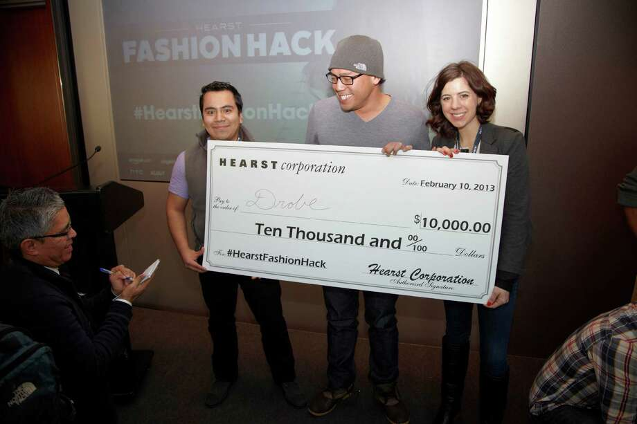 David Carey, left, president of Hearst Magazines congratulates the winners of the first Hearst Fashion Hackathon, Alan Garcia, Robby Abaya and Melissa Feudi. The trio's Drobe app took the grand prize of $10,000 and a mentorship with Hearst Digital Media, beating out 46 other teams. Photo: PHILIP FRIEDMAN/Studio D / Hearst Communications Inc., 2012