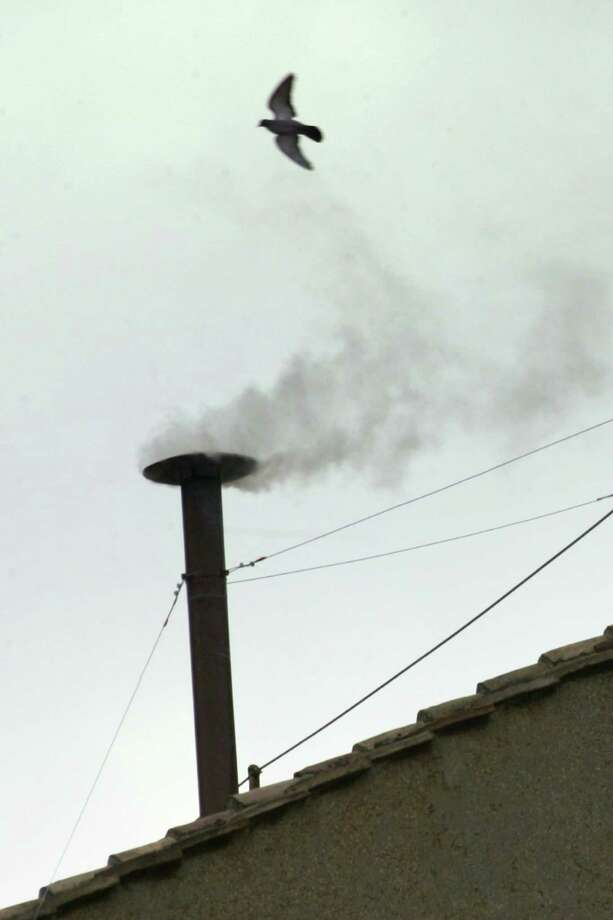 (FILES) - Picture taken 19 April 2005 at the Vatican City of white smoke ventimg up from the chimney of the Sistine Chapel meaning that Catholic Church cardinals had elected a new leader after a conclave lasting little more than 24 hours.  Pope Benedict XVI announced on February 11, 2013 he will resign because of old age, becoming the first pontiff in more than six centuries to step down in a move that stunned the world. AFP PHOTO / FILES / ANDREAS SOLAROANDREAS SOLARO/AFP/Getty Images Photo: ANDREAS SOLARO, Stringer / AFP ImageForum