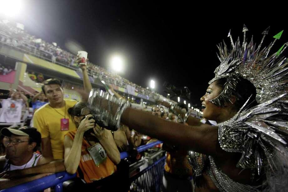 Drum queen Camilia Silva, from Mocidade Independente de Padre Miguel samba school, dances during a carnival parade at the Sambadrome in Rio de Janeiro, Monday, Feb. 11, 2013. Photo: AP