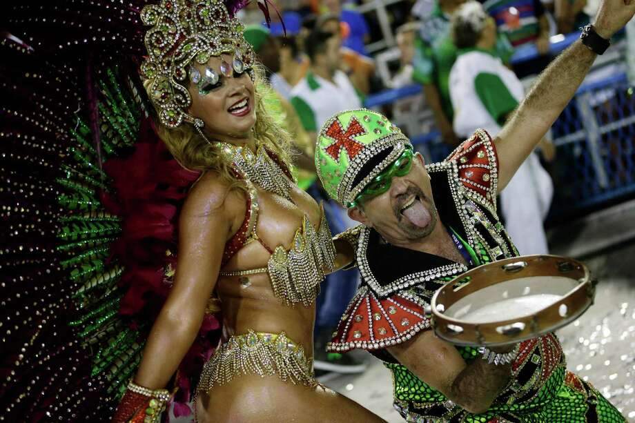 Performers from the Mocidade Independente de Padre Miguel samba school parade during carnival celebrations at the Sambadrome in Rio de Janeiro, Brazil, Monday, Feb. 11, 2013. Photo: AP