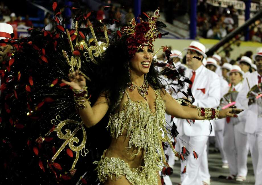 Drum queen Patricia Nery, from the Portela samba school, parades during carnival celebrations at the Sambadrome in Rio de Janeiro, Monday, Feb. 11, 2013. Photo: AP