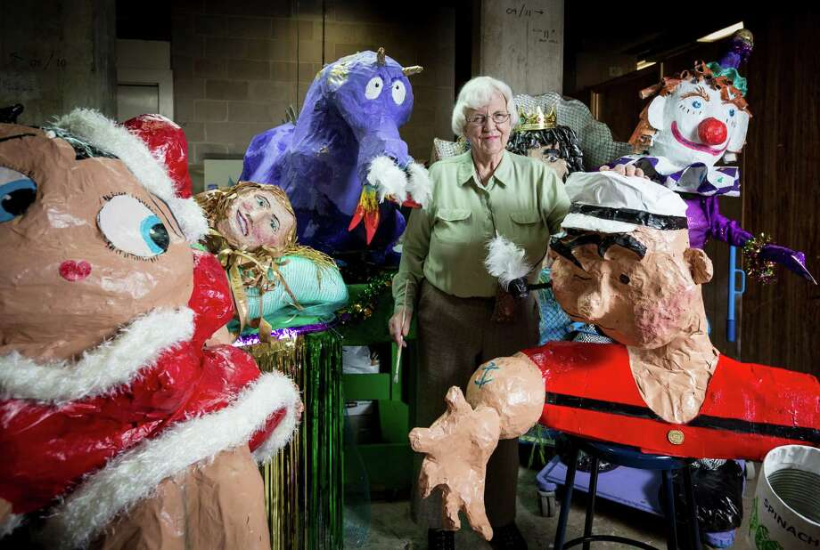 Retired art teacher Shirley Coster, 84, stands with her papier m‰chŽ Mardi Gras floats at the Bayou Manor retirement community, Wednesday, Feb. 6, 2013, in Houston. ( Michael Paulsen / Houston Chronicle ) Photo: Michael Paulsen, Staff / © 2013 Houston Chronicle