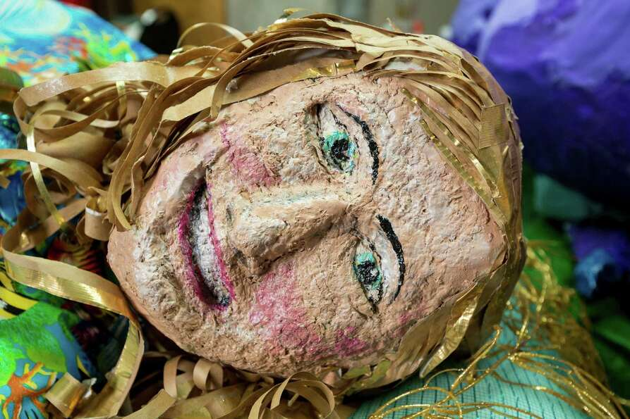 Retired art teacher Shirley Coster's papier mâché Mardi Gras floats at the Bayou Manor retirement