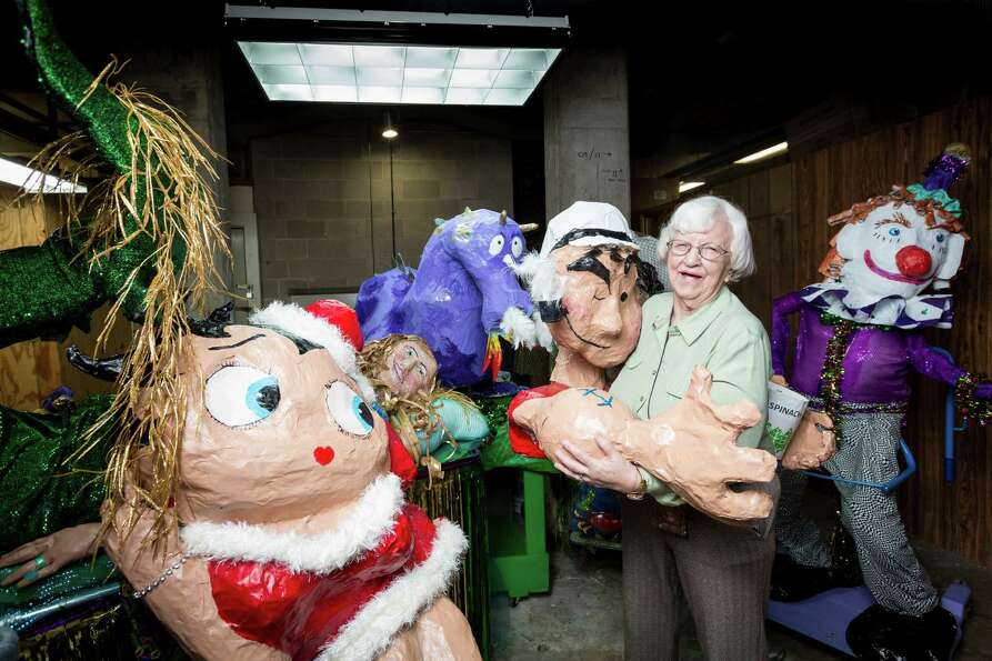 Retired art teacher Shirley Coster, 84, stands with her papier mâché Mardi Gras floats at the Bayo