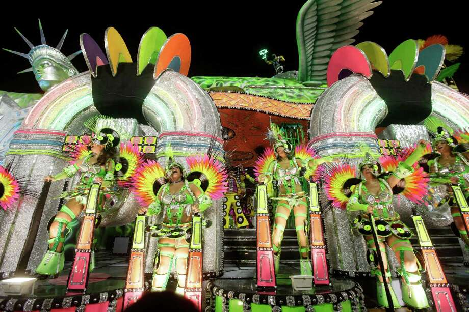 Performers from the Mocidade Independente de Padre Miguel samba school participate in the carnival celebrations at the Sambadrome in Rio de Janeiro, Monday, Feb. 11, 2013. Photo: AP