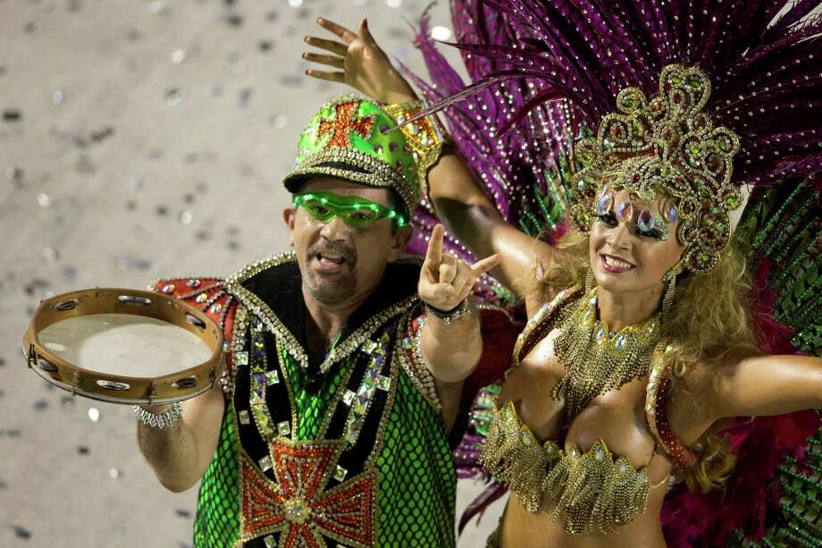 Performers from the Mocidade Independente de Padre Miguel samba school participate during carnival celebrations at the Sambadrome in Rio de Janeiro, early Monday, Feb. 11, 2013. Photo: AP