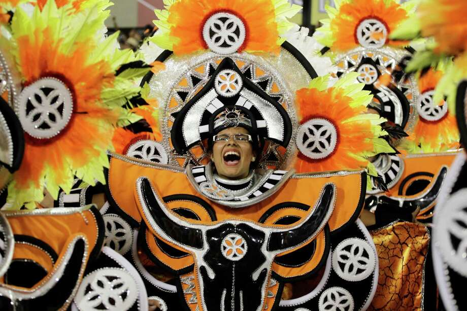 Performers from the Uniao da Ilha do Governador samba school participate in the carnival celebrations at the Sambadrome in Rio de Janeiro, Monday, Feb. 11, 2013. Photo: AP