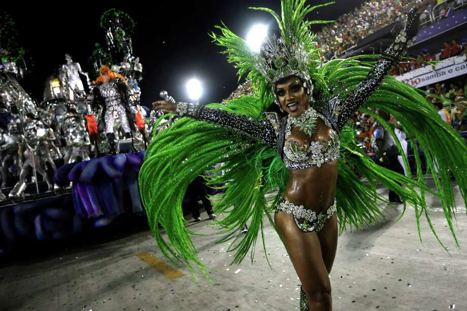 A performer from the Mocidade Independente de Padre Miguel samba school dances during carnival celebrations at the Sambadrome in Rio de Janeiro, Monday, Feb. 11, 2013. Photo: AP