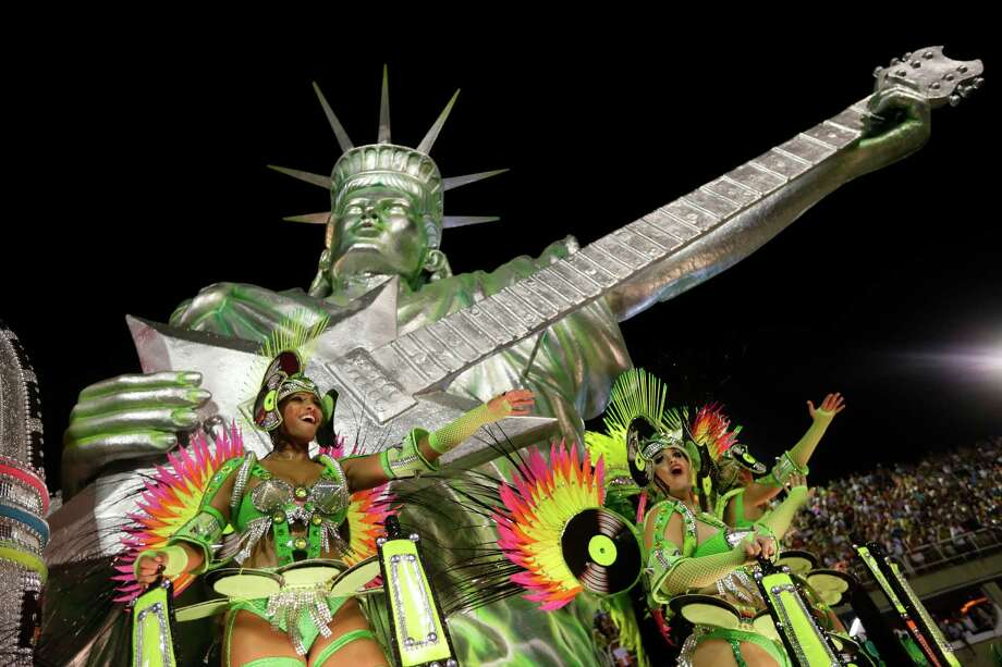 Performers from the Mocidade Independente de Padre Miguel samba school parade during carnival celebrations at the Sambadrome in Rio de Janeiro, Monday, Feb. 11, 2013. Photo: AP