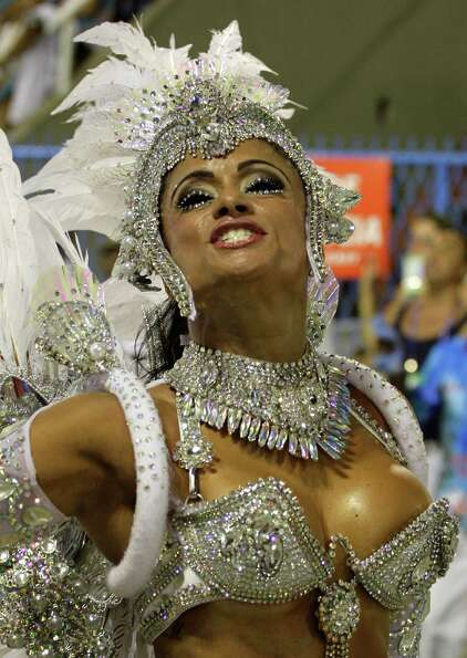Performers from the Uniao da Ilha do Governador samba school parade during carnival celebrations at