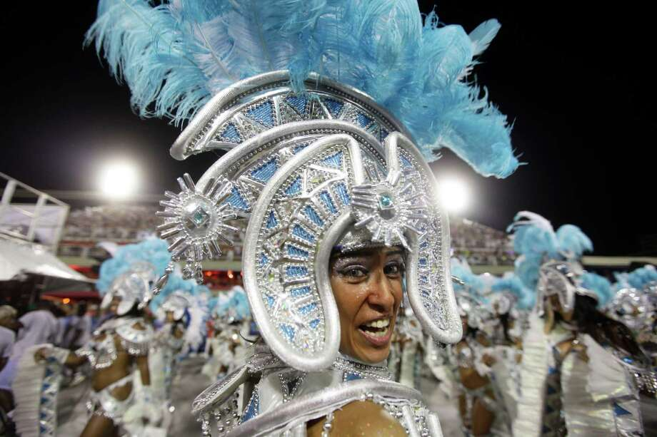 Performers from the Uniao da Ilha do Governador samba school parade during carnival celebrations at the Sambadrome in Rio de Janeiro, Brazil, Monday, Feb. 11, 2013. Photo: AP