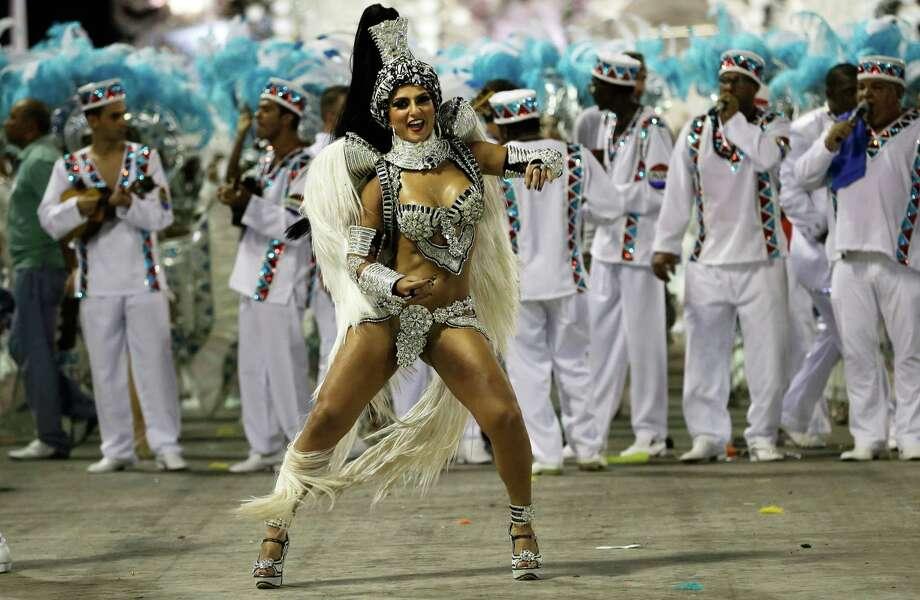 Drum queen Bruna Bruno, from Uniao da Ilha do Governador samba school, dances during carnival parade at the Sambadrome in Rio de Janeiro, Brazil, Monday, Feb. 11, 2013. Photo: AP