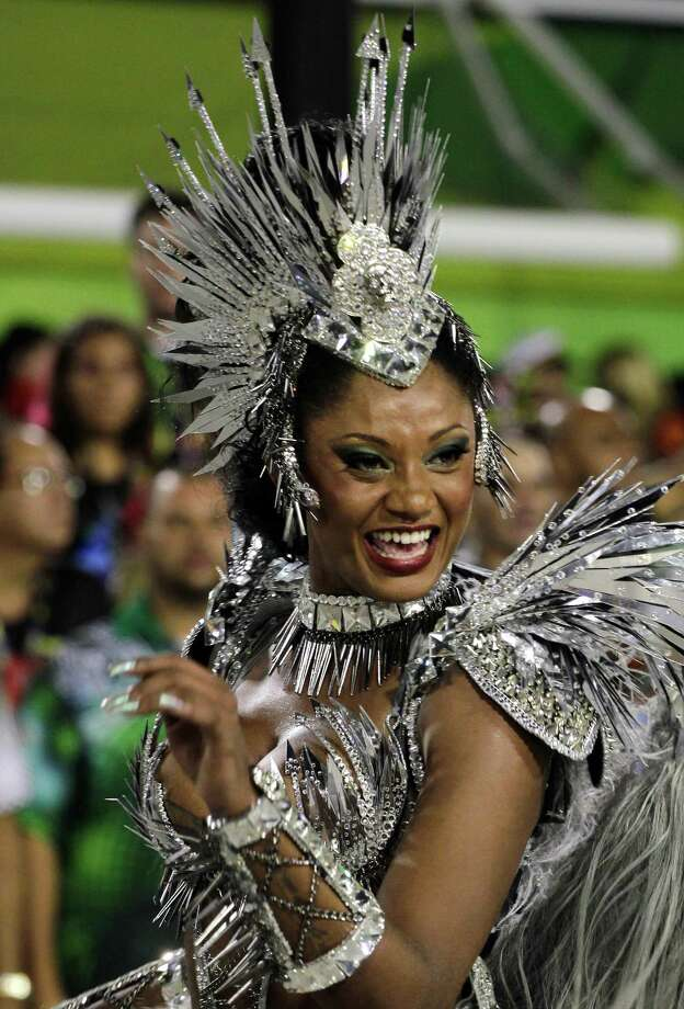 Drum queen Camilia Silva, from Mocidade Independente de Padre Miguel samba school, dances during a carnival parade  at the Sambadrome in Rio de Janeiro, Monday, Feb. 11, 2013. Photo: AP