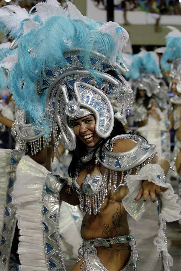 Performers from the Uniao da Ilha do Governador samba school parade during carnival celebrations at the Sambadrome in Rio de Janeiro, Brazil, Monday, Feb. 11, 2013. Photo: AP