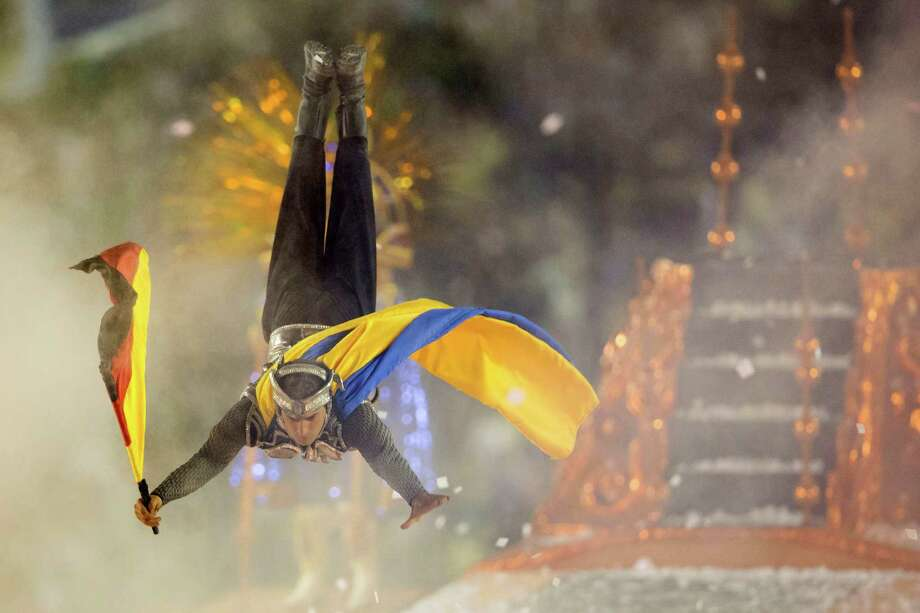 A performer from the Unidos da Tijuca samba school jumps on a float during carnival celebrations at the Sambadrome in Rio de Janeiro, Brazil, early Monday, Feb. 11, 2013. Photo: AP