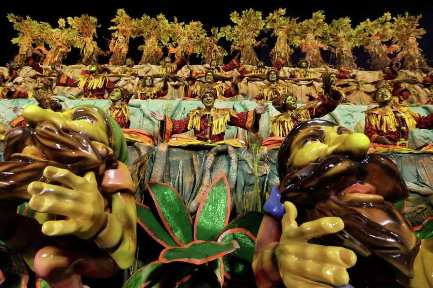 Performers from the Unidos da Tijuca samba school parade during carnival celebrations at the Sambadr