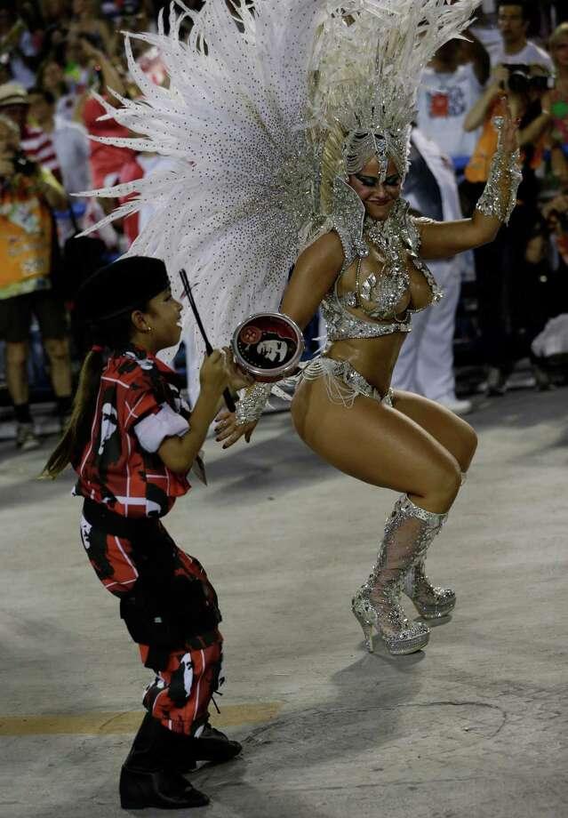 Performers from the Academicos do Salgueiro samba school parade during carnival celebrations at the Sambadrome in Rio de Janeiro, Brazil, Monday, Feb. 11, 2013. Photo: AP