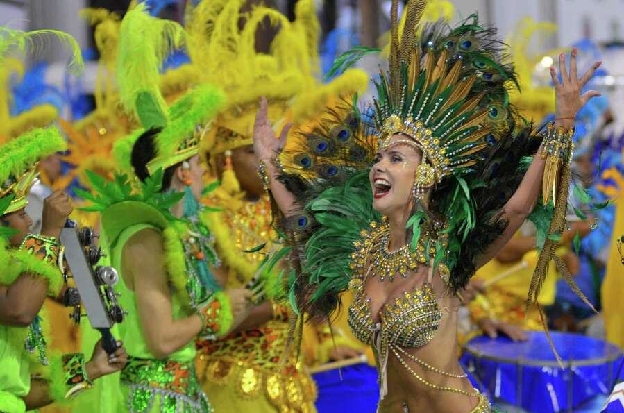 Dancers of the samba school Peruche dance during the carnival parade at the Anhembi Sambadrome on Fe