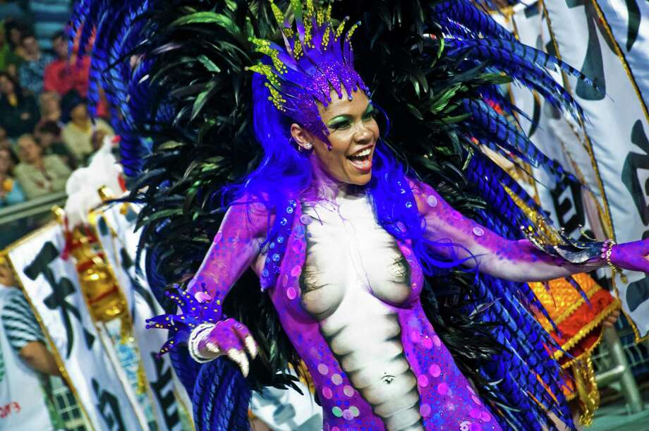 Dancers of the samba school X9 Paulistana dance during the carnival parade at the Anhembi Sambadrome on February 09, 2013 in Sao Paulo, Brazil. Photo: Getty
