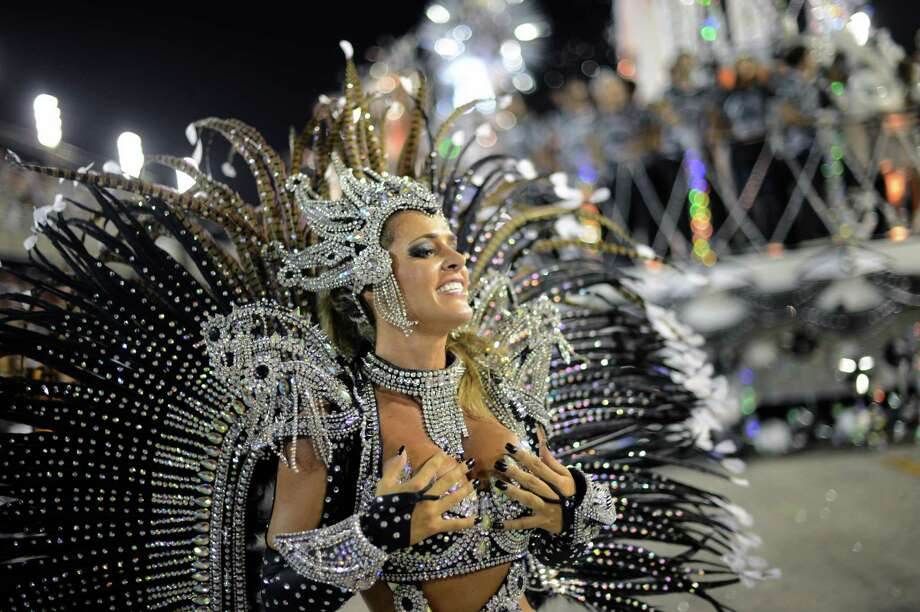 A reveler of Uniao da Ilhia samba school performs during the first night of Carnival parade at the Sambadrome in Rio de Janeiro on February 11, 2013.     AFP PHOTO / CHRISTOPHE SIMON Photo: Getty