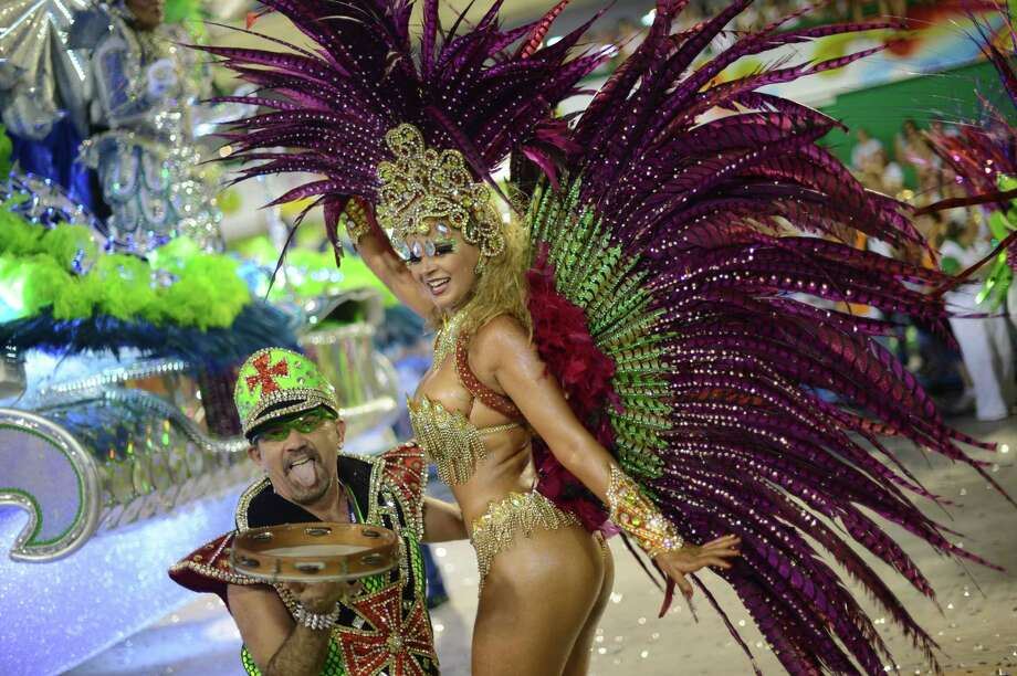 Revelers of Uniao da Ilhia samba school perform during the first night of Carnival parade at the Sambadrome in Rio de Janeiro on February 11, 2013.     AFP PHOTO / CHRISTOPHE SIMON Photo: Getty